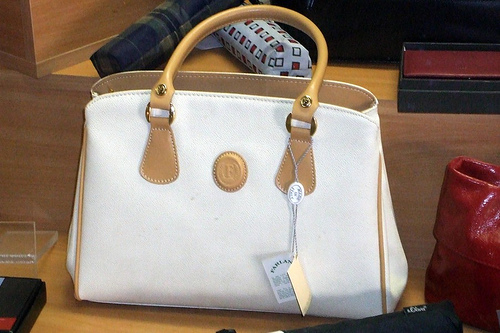 beige and white handbag